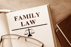family law in El Paso, law book open with a pair of glasses ontop