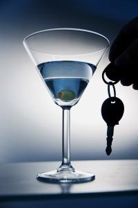 DWI, martini glass with car keys next to it