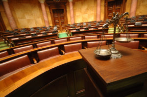 symbol of justice in an empty courtroom family law