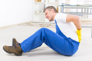 Man worker with back injury who may need a personal injury lawyer
