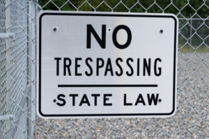 No Trespassing Sign on Security Fence