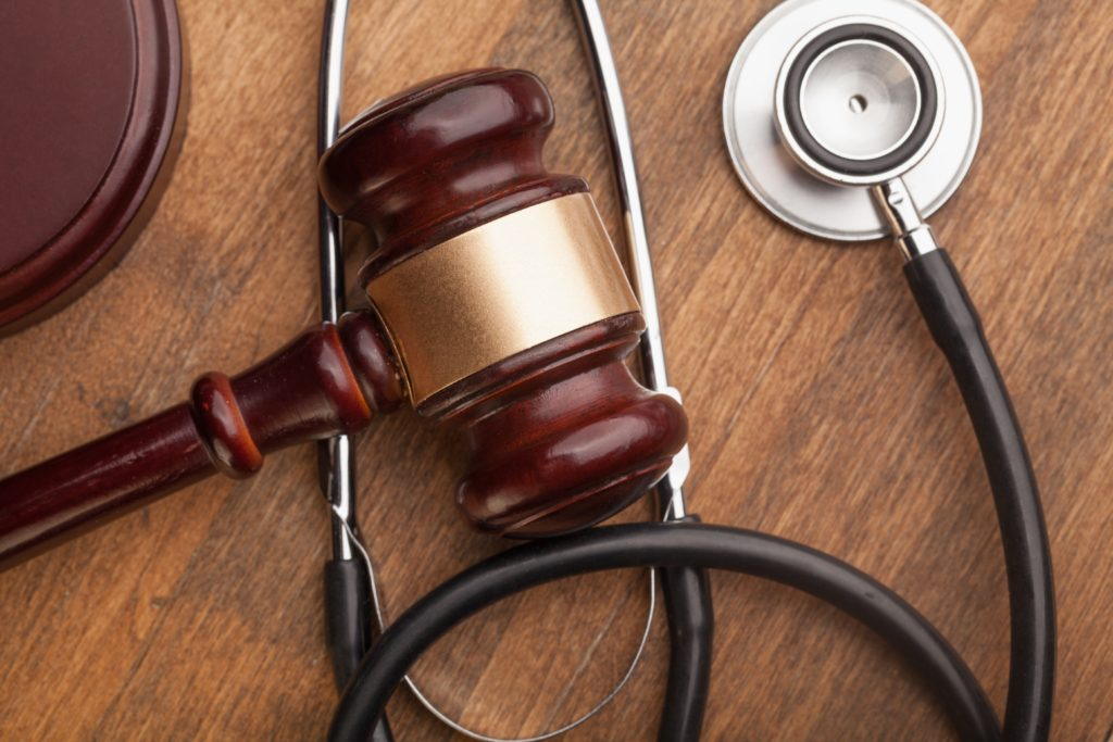 stethoscope and gavel indicating personal injury lawyer symbolism