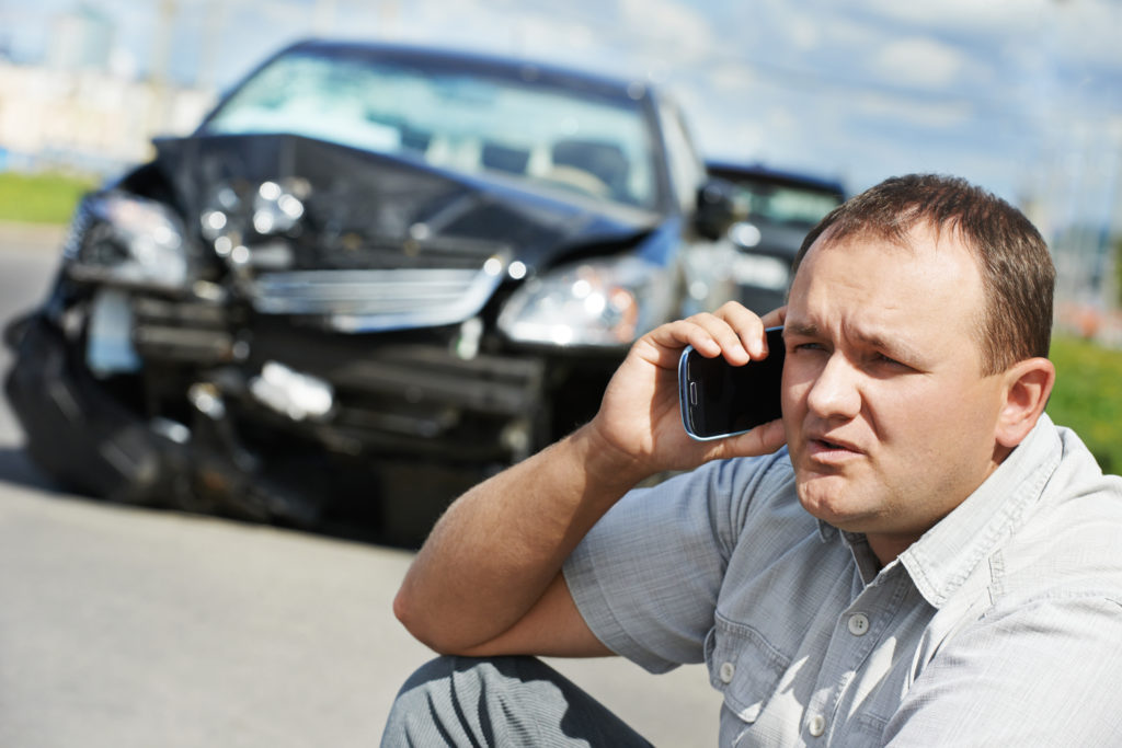 a man calling his car accident lawyer after he got in a car accident